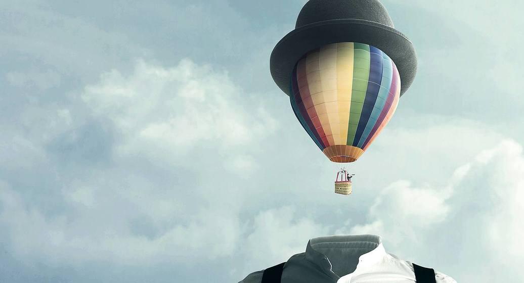 Man med luftballong som hode. Illustrasjonsfoto
